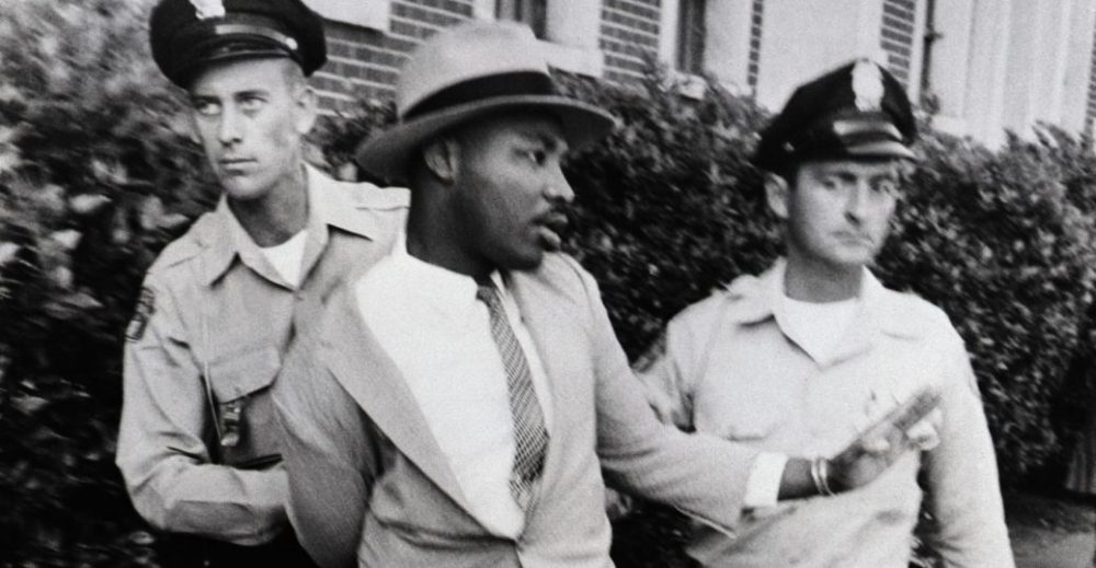 Martin Luther King Jr is arrested by two white police officers in Montgomery Alabama on September 4, 1958 | Source: History.com