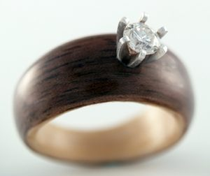 Walnut and Maple engagement ring with salvaged diamond setting