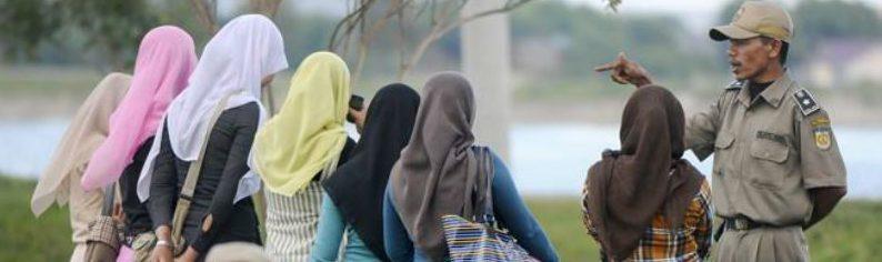 "Indonesian Lesbian Couple Face ""Rehabilitation"" After Arrest"